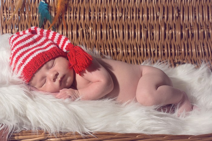 Baby in stripy hat