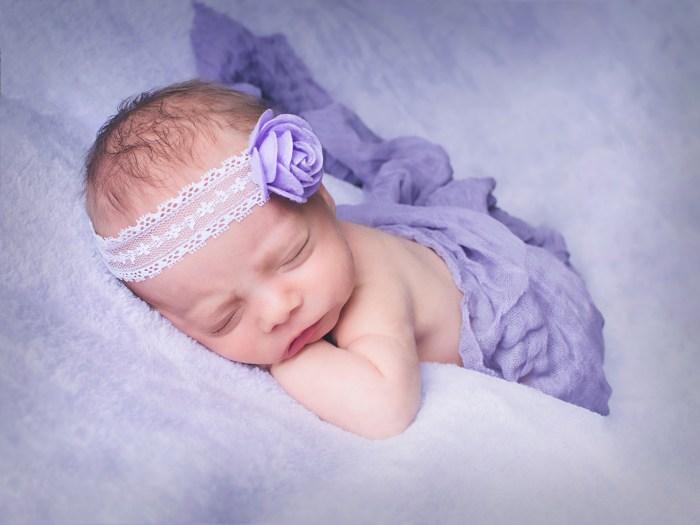 baby in purple headband