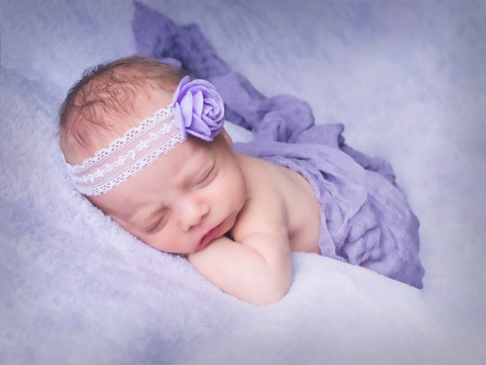 baby in purple headband