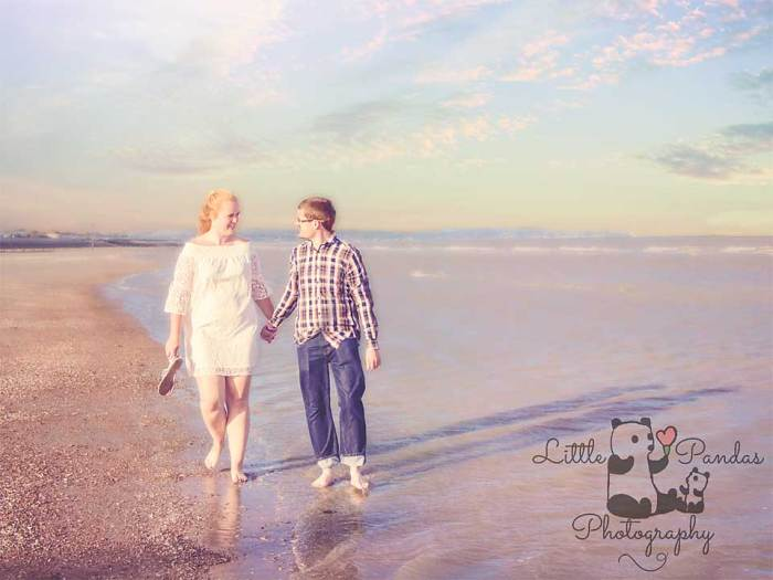 Engagement couple walking by the sea