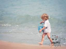 Little boy with blue bucket