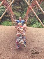 Family on log swing