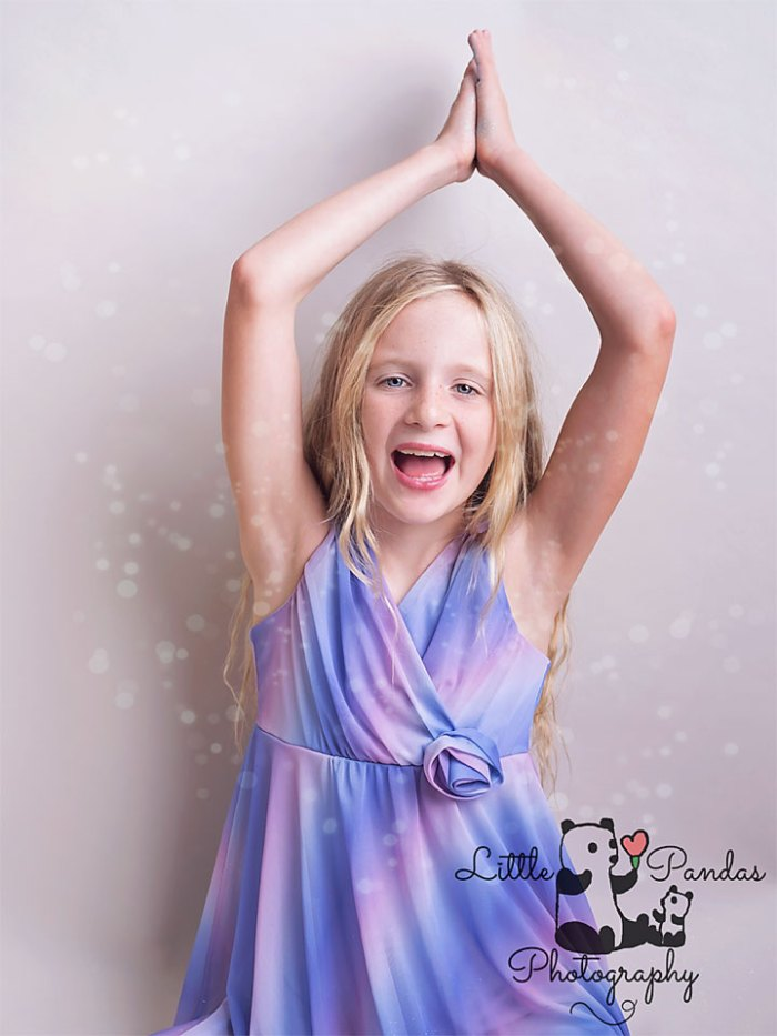Girl with glitter falling on her