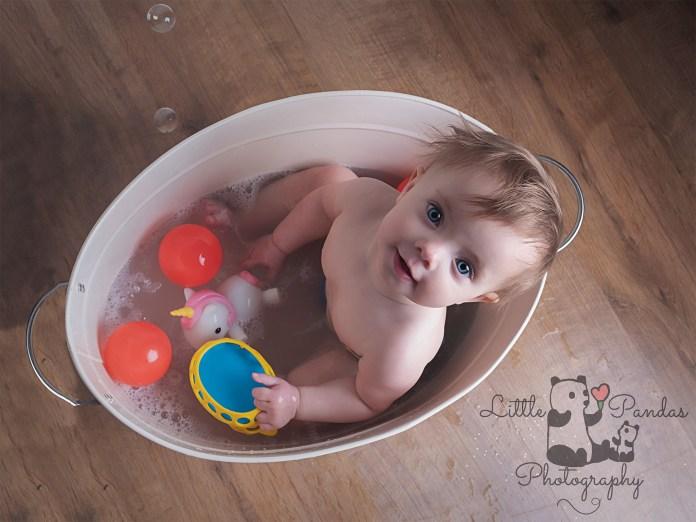 Little girl in tin bath aerial view
