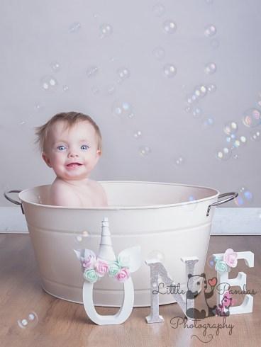 Little girl smiling in tin bath