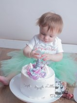 Little girl eating cake