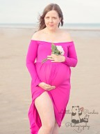 Pregnant lady in pink dress with flowers