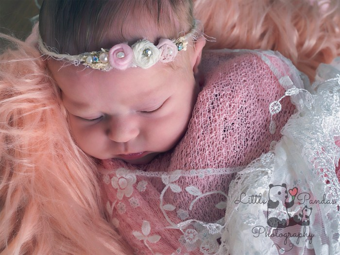 Newborn baby girl close up pink headband