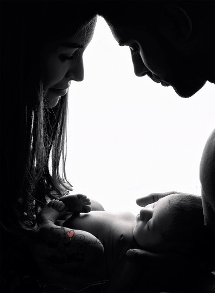 Newborn photography parents with baby silhouette