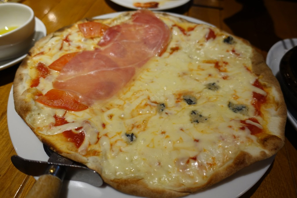 Half and half pizza. Tomato and ham on one side, cheese on the other!