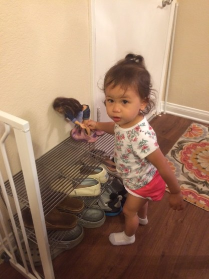 Putting her shoes onto Lamily