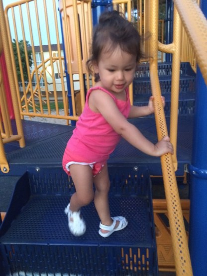 """It was a hot day, so I was fine with her in just a diaper, but Jeff insisted on putting a shirt on her for her """"ride pink car."""" Good thing, because she wanted to go to the playground!"""