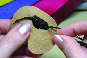 Tying off a satin stitch