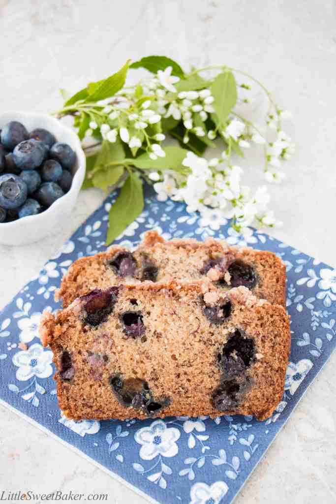 This is a moist flavorful banana bread, studded with delicious blueberries, topped with a crunchy sweet cinnamon streusel, and made without eggs. (video recipe)