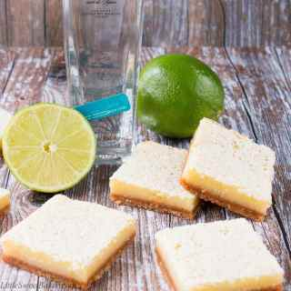 These zesty and sweet lime bars are to die for. They are bursting with a tangy lime taste and pack a punch of tequila flavor.
