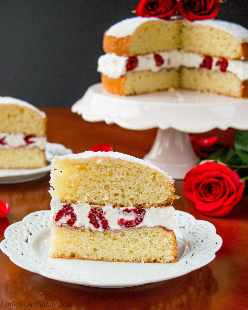 A buttery and tender British style sponge cake layered with raspberry jam and whipped cream in between. This version is jazzes up with the addition of fresh raspberries in the filling.