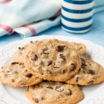 These ultra easy cookies is all made by hand and in one bowl. It only takes 10 mins to whip up these delicious chewy cookies and 10 mins to bake them - that's it! #chocolatechipcookies #easychocolatechipcookies #christmascookies #chewychocolatechipcookies