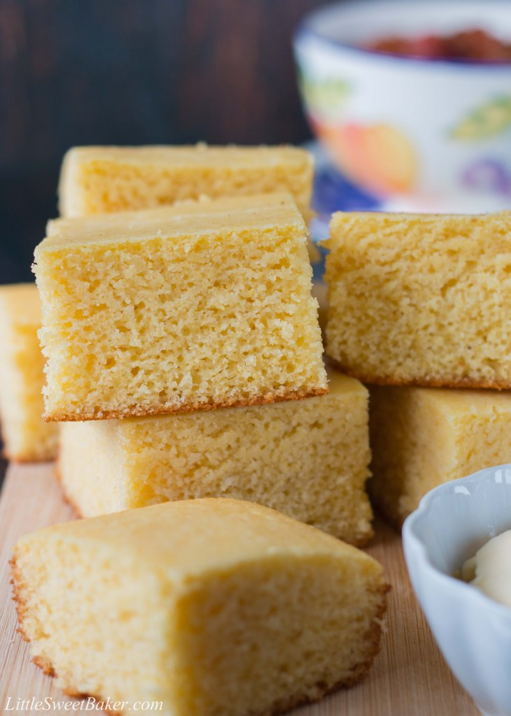 This moist, fluffy and tender cornbread is a perfect addition to any meal. This quick and easy recipe can be prepared, baked and ready to serve in under 30 minutes. #cornbreadrecipe #sweetcornbread #buttermilkcornbread #southerncornbread #easycornbread