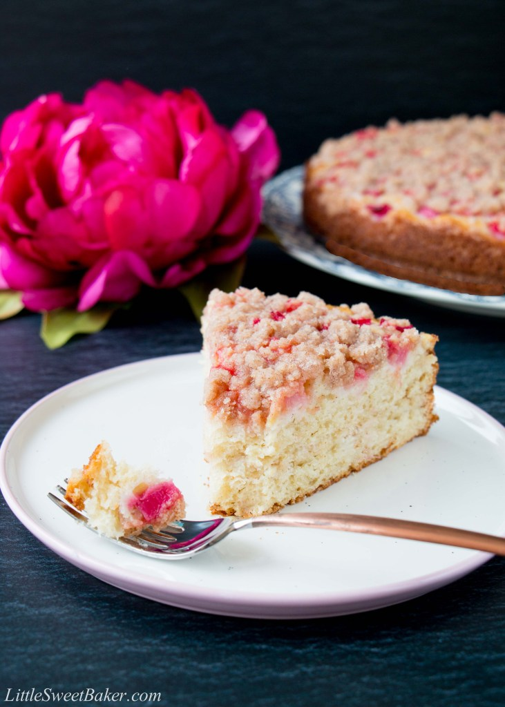 This is a tender and moist sour cream coffee cake topped with juicy pink chunks of rhubarb and a sweet-cinnamon streusel. #rhubarbcake #coffeecake #cinnamonstreusel