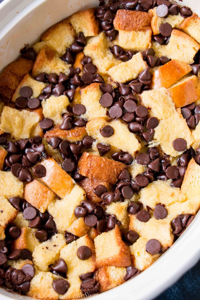 This classic recipe is elevated with the addition of chocolate and rich-buttery brioche bread. #breadpudding #chocolatechipbreadpudding #bourbonsauce #whiskeysauce #NewOrleansstyle