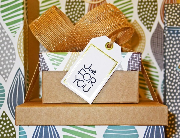 "Gift boxes stacked with a bow on top and tag that reads ""just for you"""