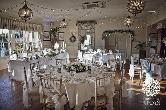 white chair sashes dark green cushions winter wedding inspiration at the shireburn arms