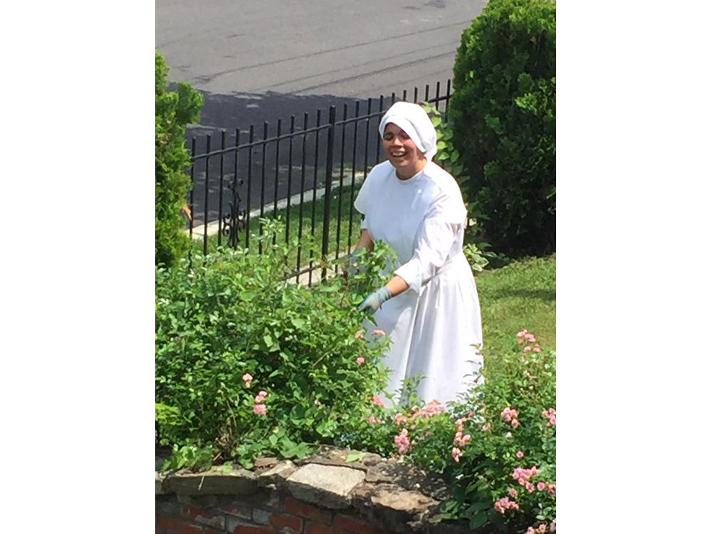 Sister Graziella working hard in the yard