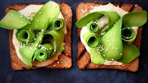 Curls of shaved avocado turn regular avocado toast into a work of art. (Photos: fooddeco/Instagram.)