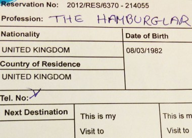 Completing Hotel Check-In Form (Occupation: the Hamburglar)