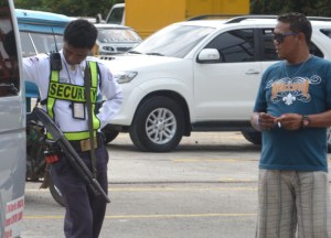 Shotgun Armed Security Guard in Manila Philippines, Southeast Asia.