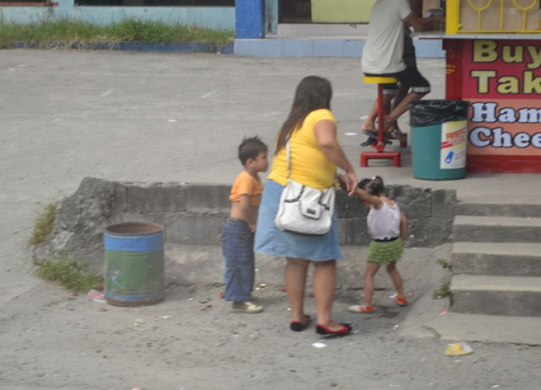 Boy Urinating in Street on Stopover at Clark Airport, Southeast Asia