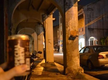 Drinking Special Brew outside hostel in Georgetown, Southeast Asia