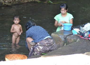 Washing in River, Escape Tourism in Ubud Cultural Capital of Bali
