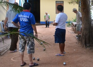 Savannakhet Vietnamese Consulate, Playing Petanque in Laos, French  Influences