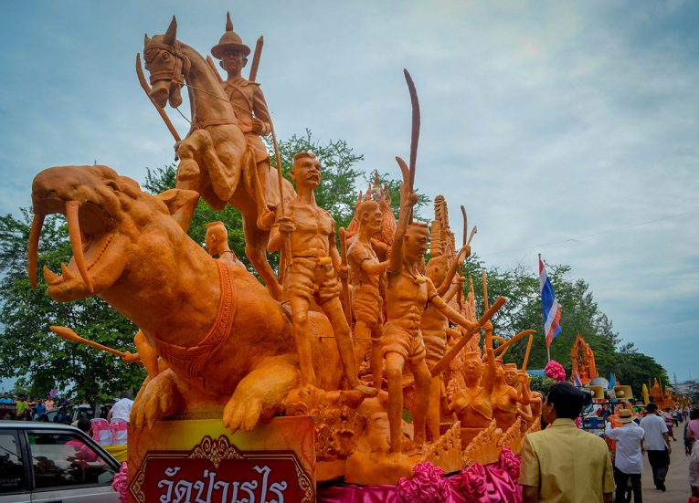 Carved Sculptures and Scenes on Big Candle Festival in Isaan Thailand for Thai Lent