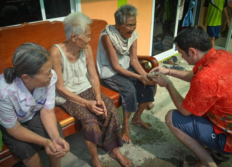 Paying Respects to Elderly Twins in Nang Rong Songkran Festival in Thailand