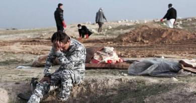 LLL-Live Let Live-Child's tiny body is among two dozen corpses found in mass grave discovered in Mosul