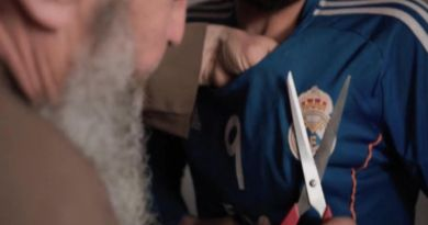 LLL-Live Let Live-ISIS terrorist uses scissors to remove Real Madrid badge from youth's shirt