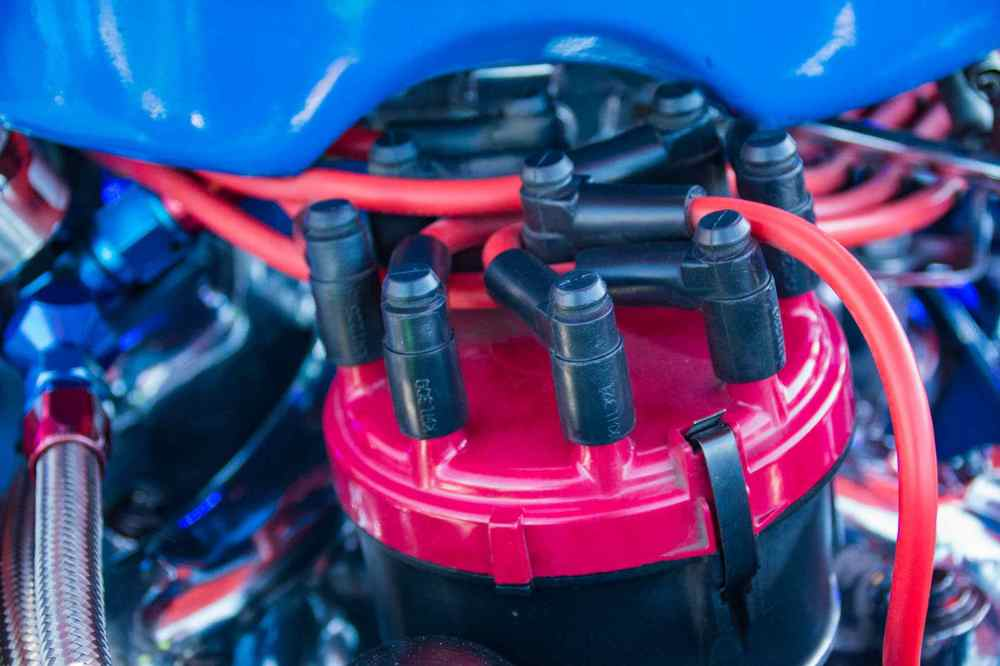 medium resolution of distributor cap and spark plugs in a classic car close up