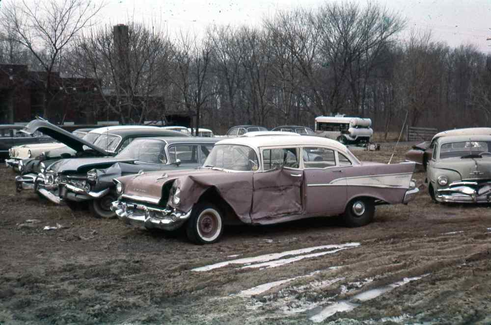 medium resolution of the gm ignition module junkyard with multiple cars and three old chevy models in a late fall landscape