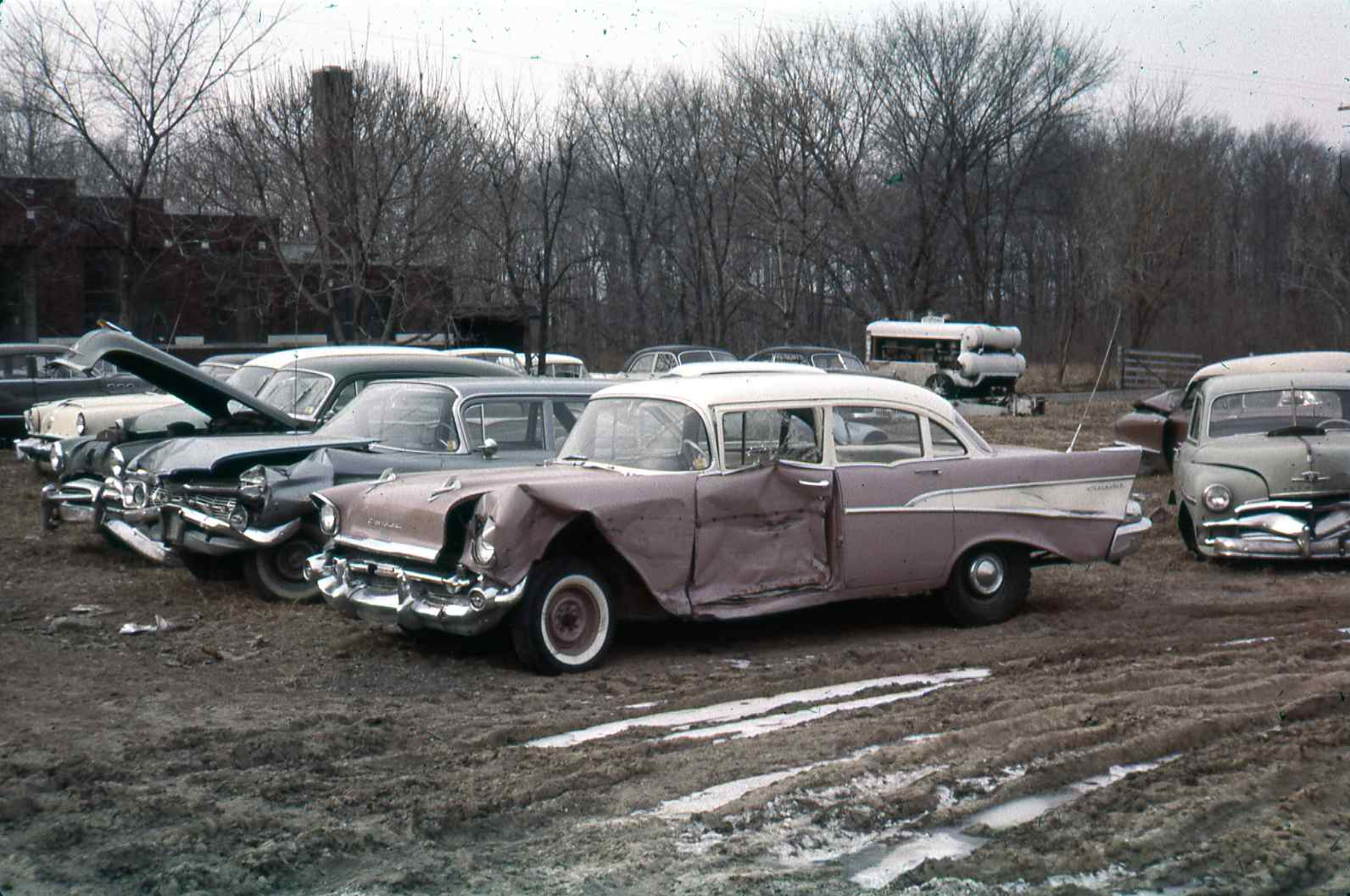 hight resolution of the gm ignition module junkyard with multiple cars and three old chevy models in a late fall landscape