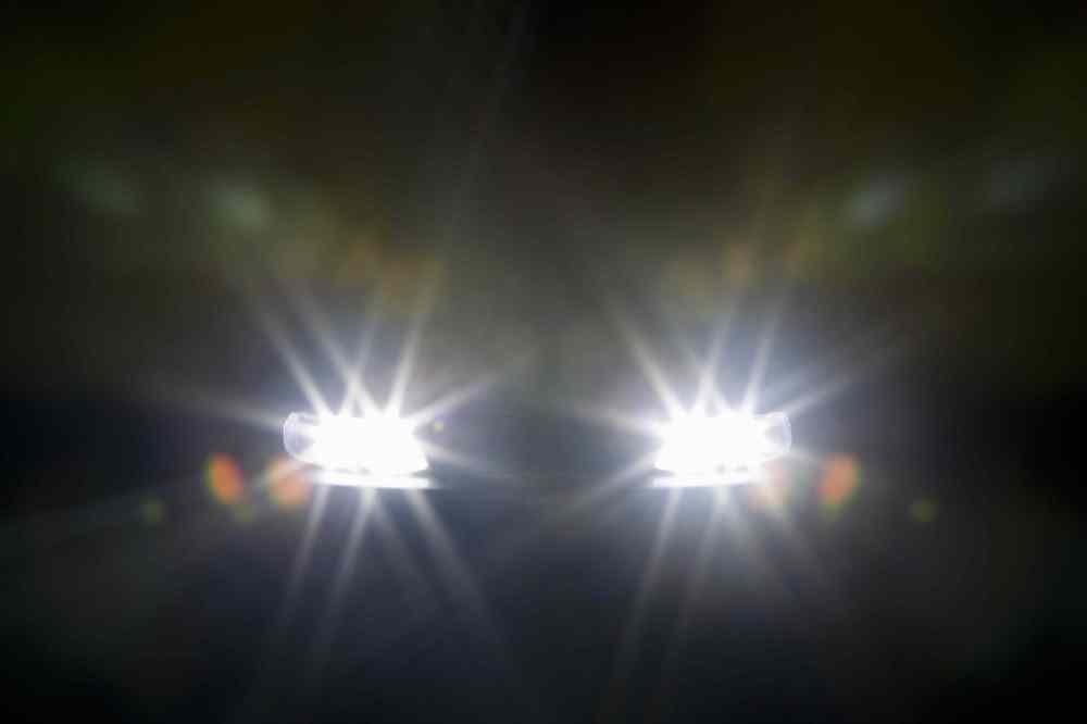 medium resolution of a car headlights illuminated at night