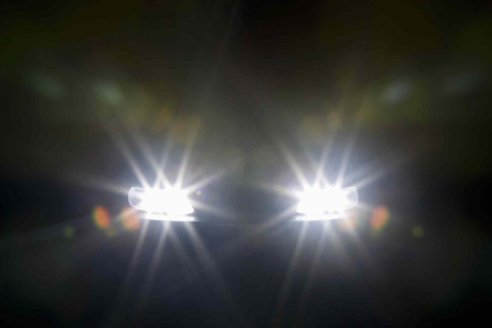 hight resolution of a car headlights illuminated at night