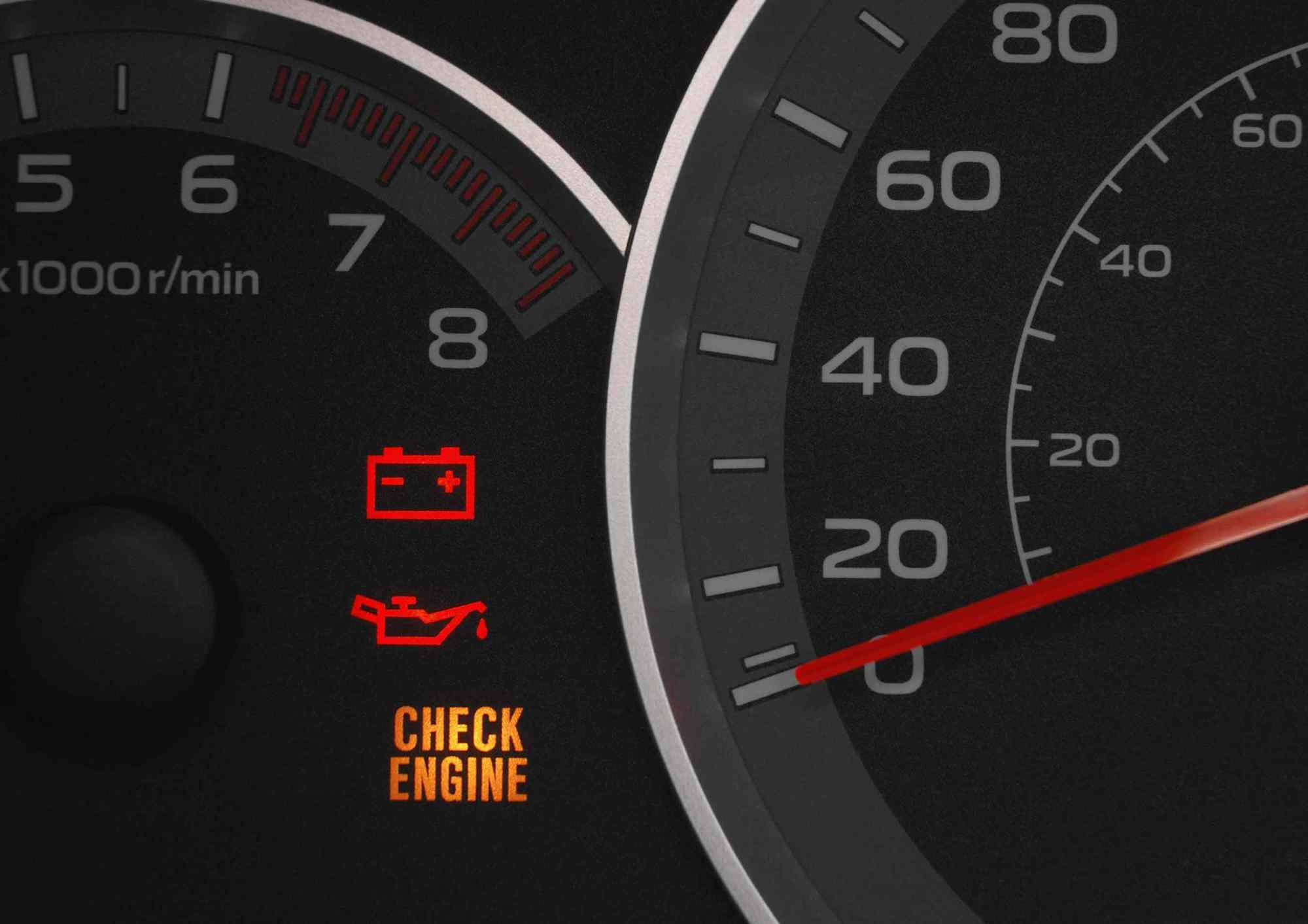 hight resolution of close up on a cluster with the check engine warning light on indicating a car failure