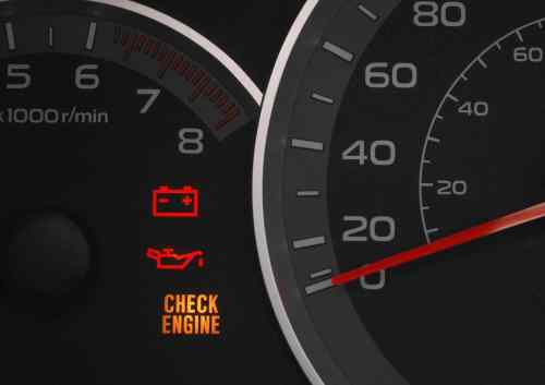 small resolution of close up on a cluster with the check engine warning light on indicating a car failure