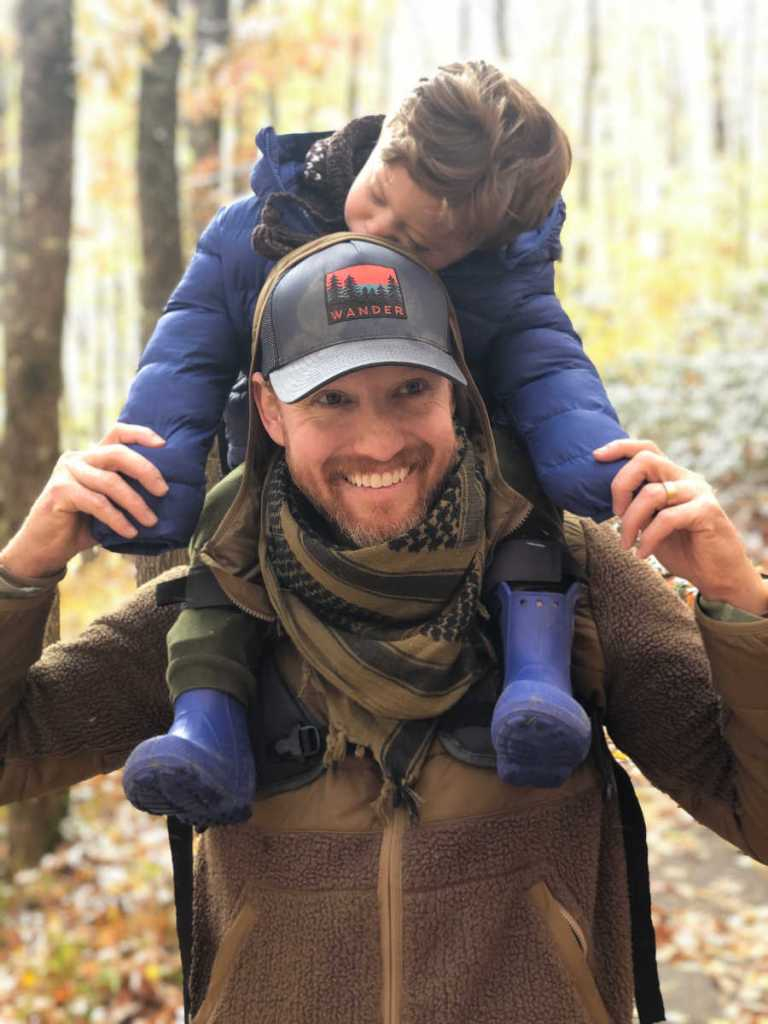 Toddler Sleeping on Shoulders of Dad