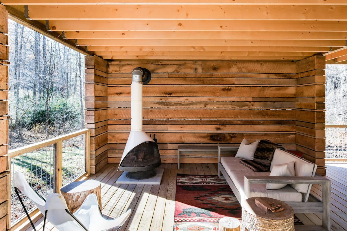 covered wooden patio with fireplace