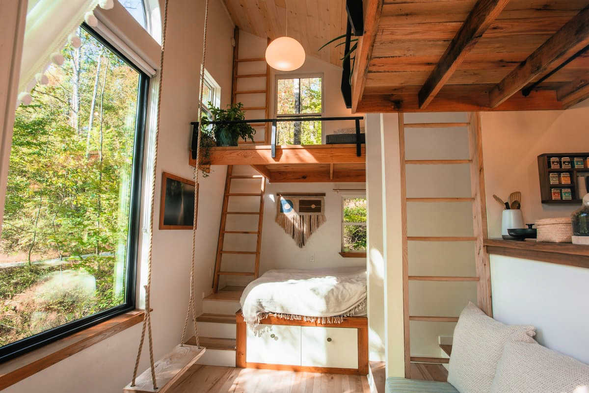 airy loft with bed and stairs