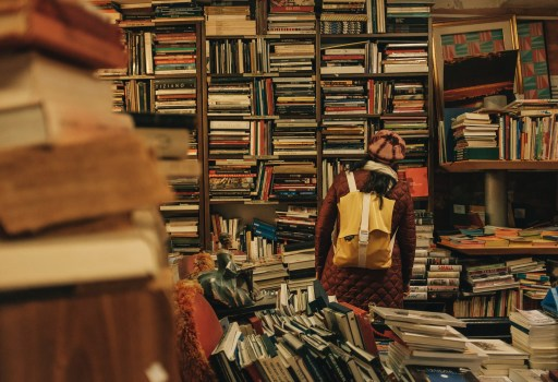 woman stood in the midst of cluttered books