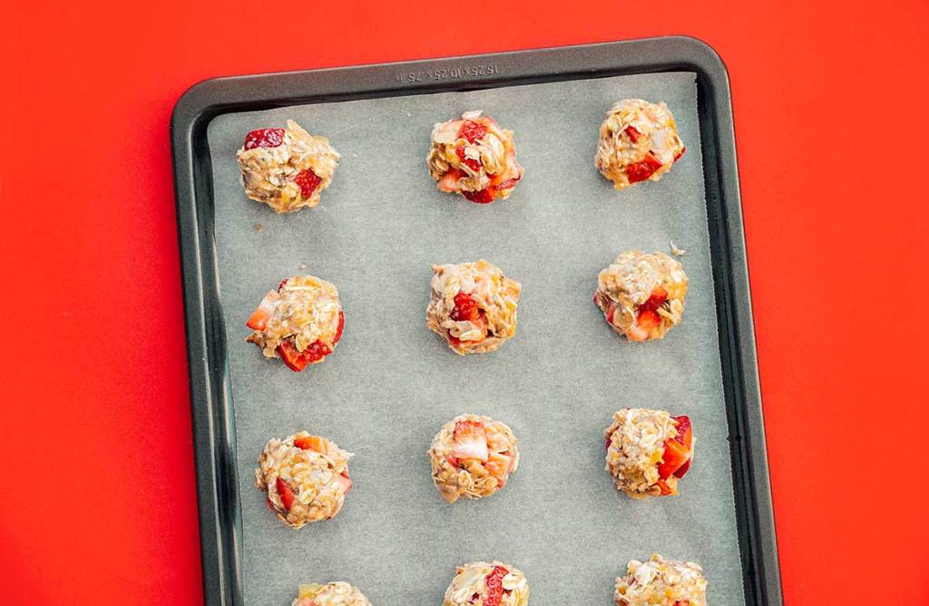 Oat and strawberry cookies on a baking sheet